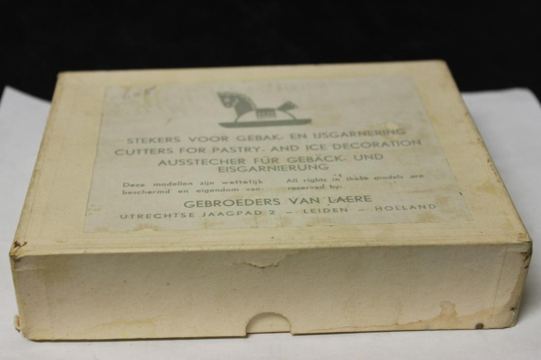 A Set of 4 Vintage Molds