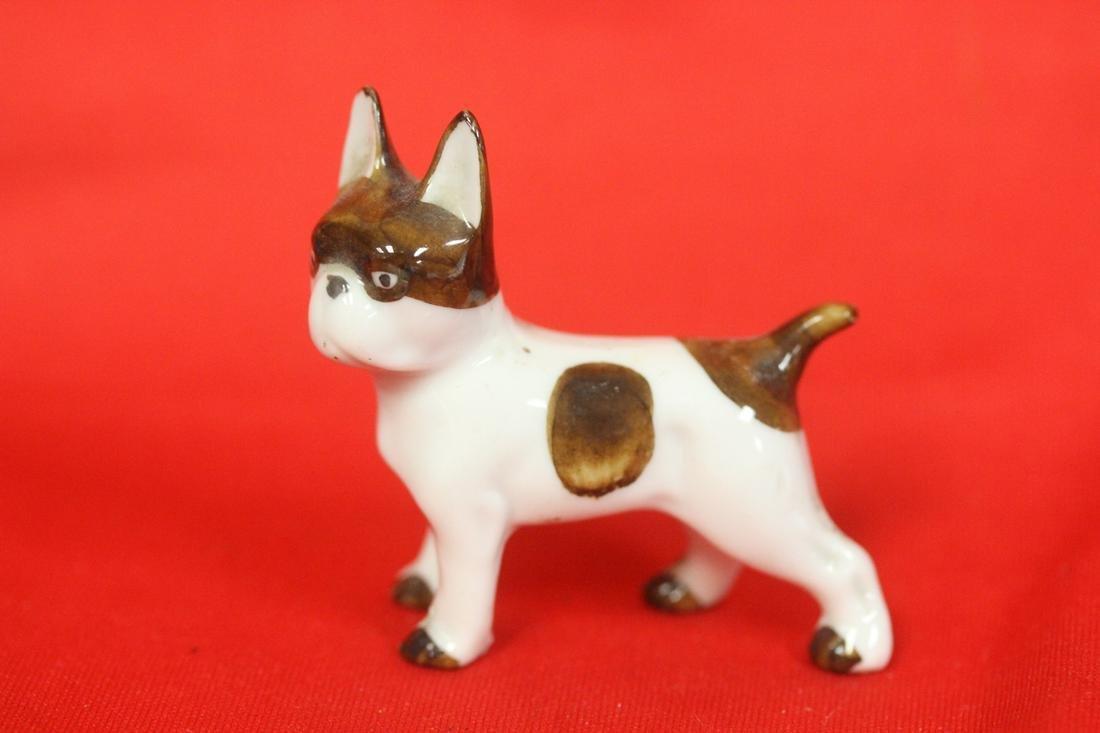 A Miniature  Porcelain Dog