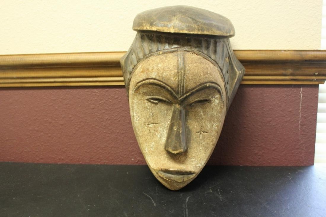 A Vintage Wooden Mask