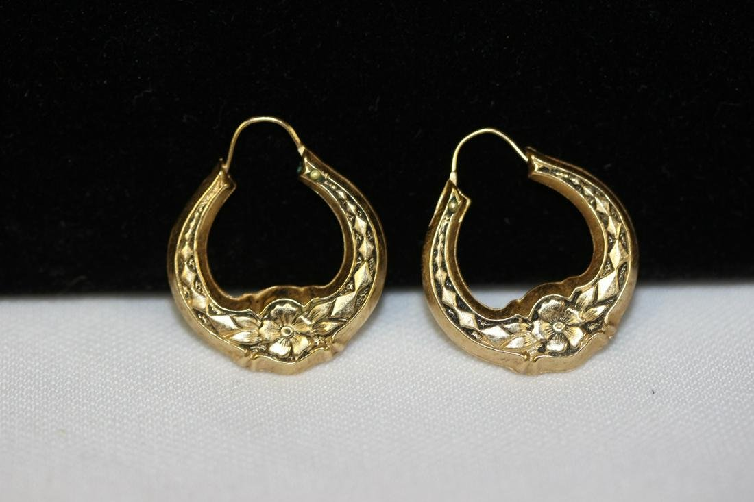 A Pair of 14 Karat Gold Earrings