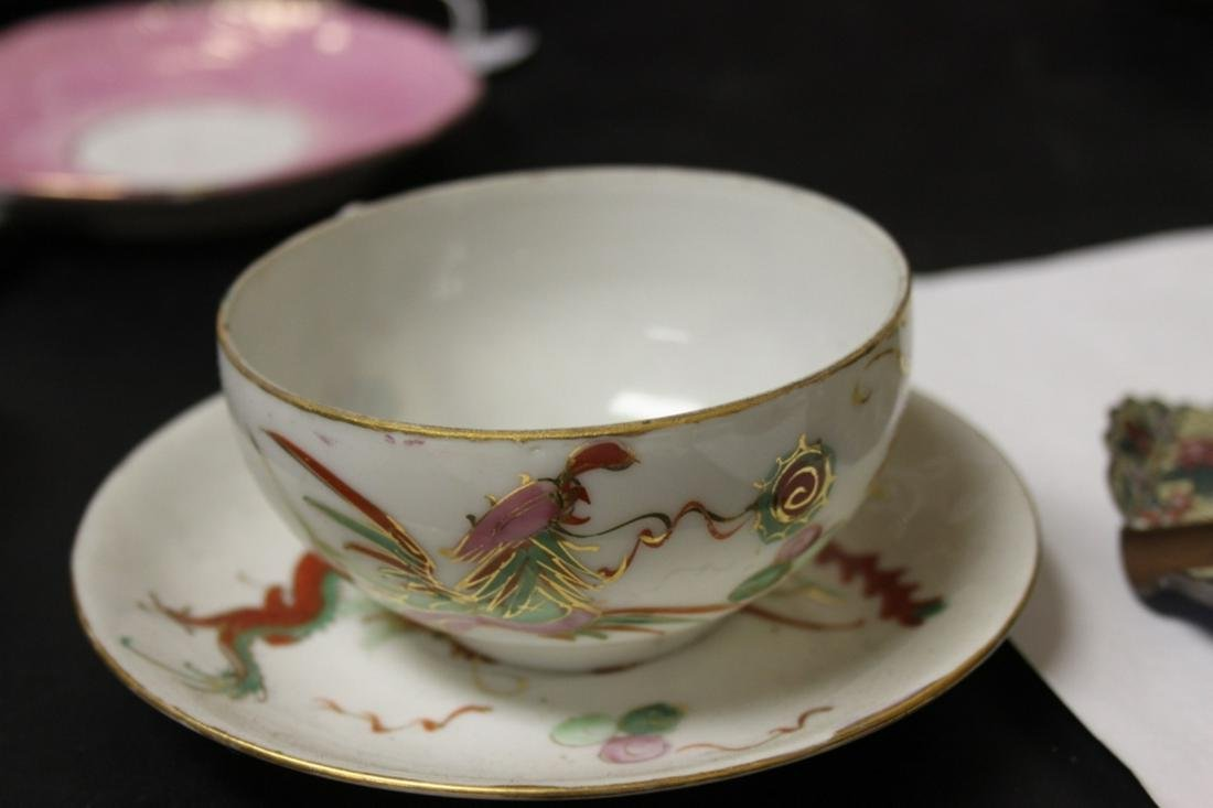 A Chinese Cup and Saucer - Dragon and Phoenix Motif