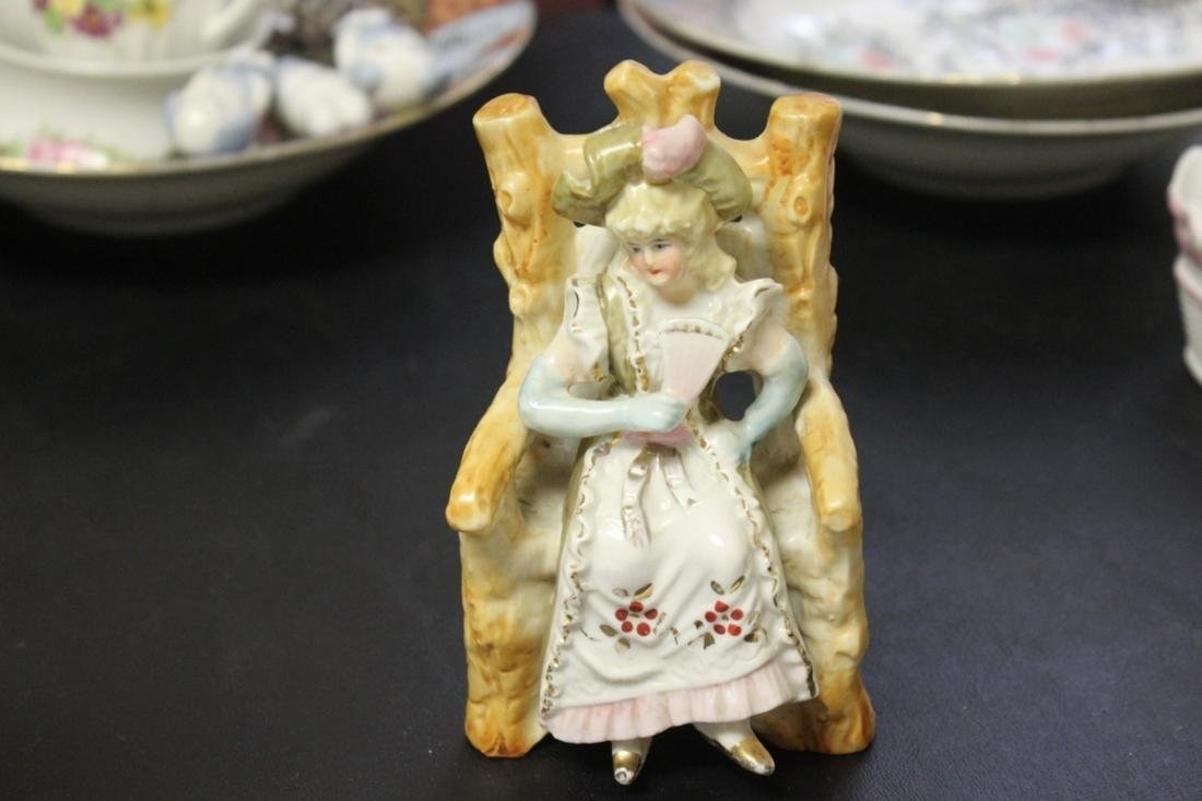 A Seated Ceramic Figure