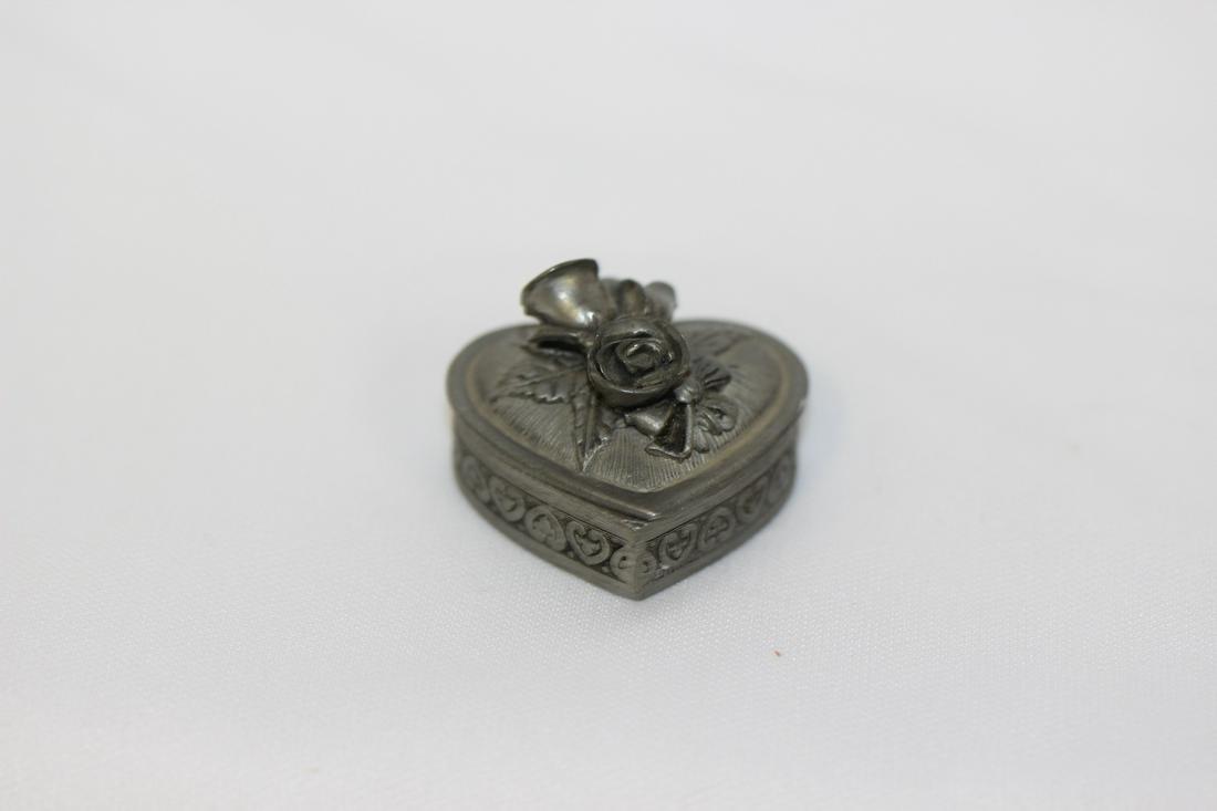 A Metal Heart Shape Trinket Box