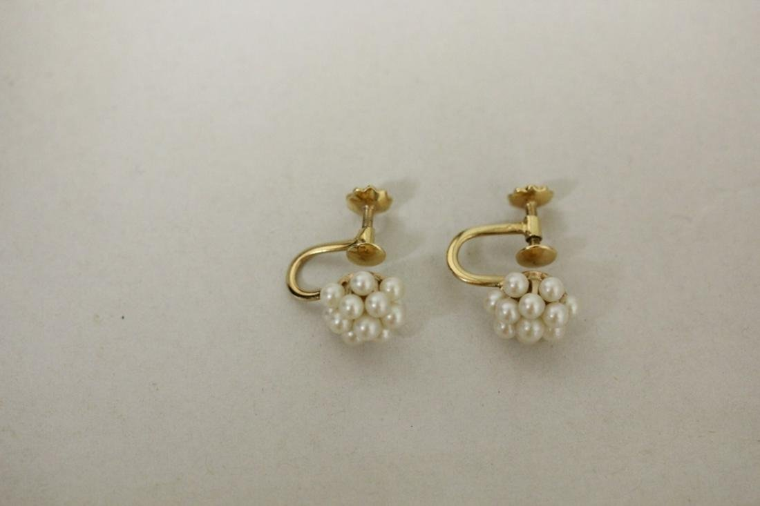 A Pair of 14 Karat Gold and Pearl Earrings