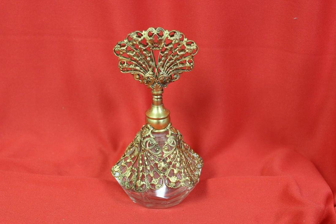 A Gold Plated Overlay Parfume Bottle