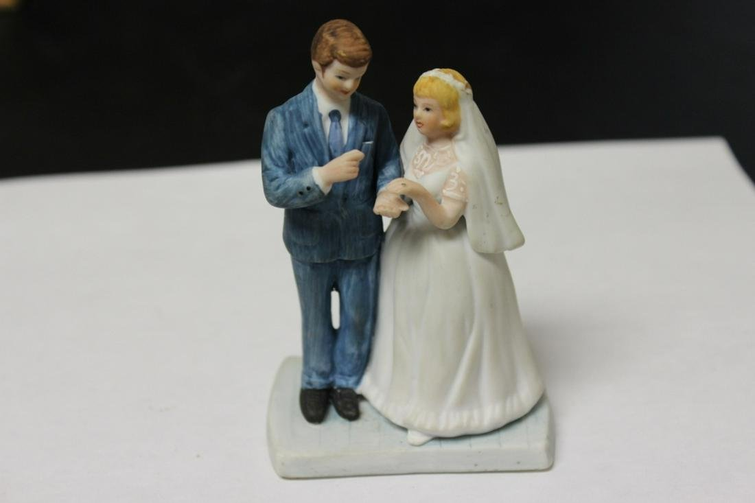 A Porcelain Norman Rockwell Bride and Groom Cake Topper