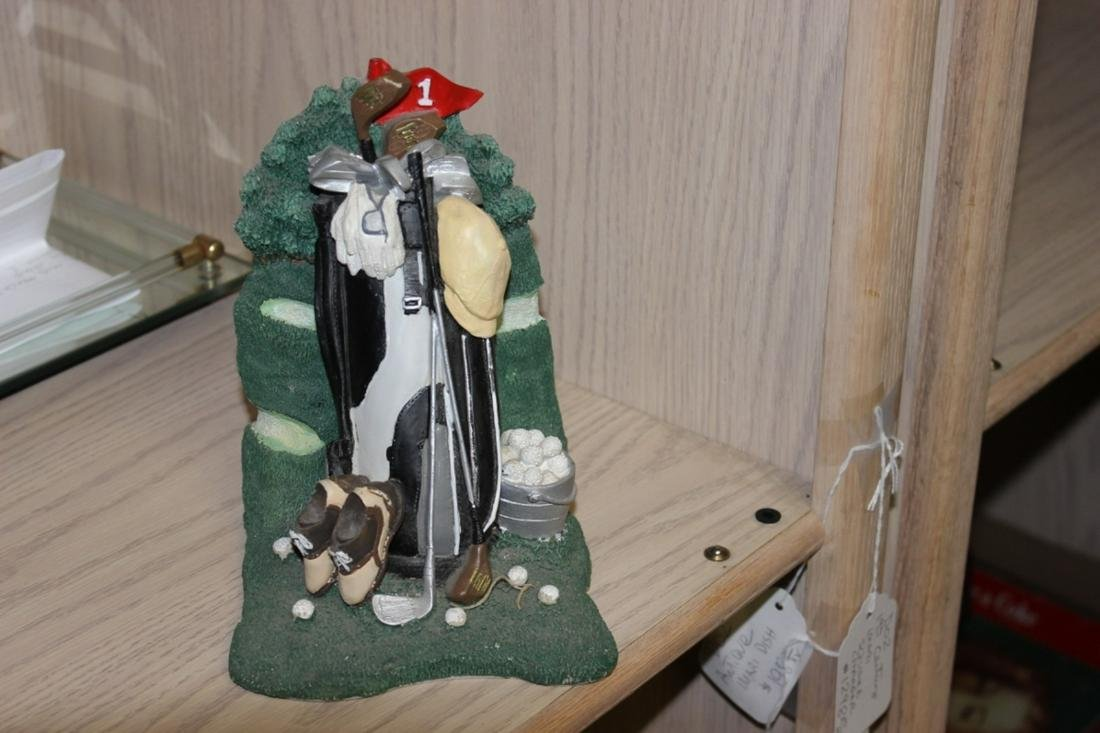 A Statue of Golf Clubs in Bag
