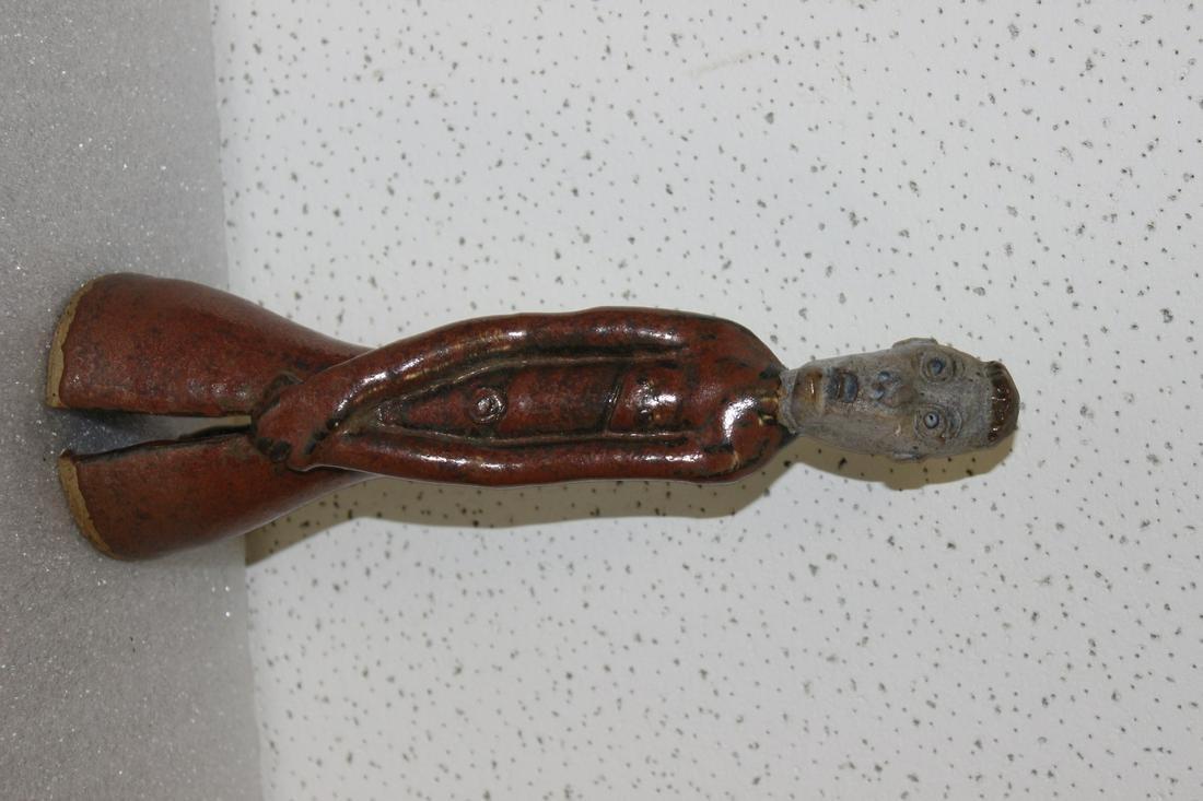 A Signed BG Pottery Figure