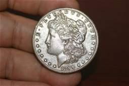 An 1899O Toned Morgan Silver Dollar