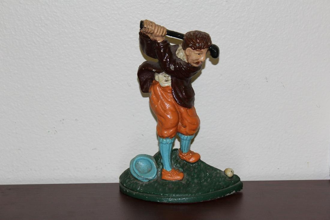 A Signed Vintage Cast Iron Golfer