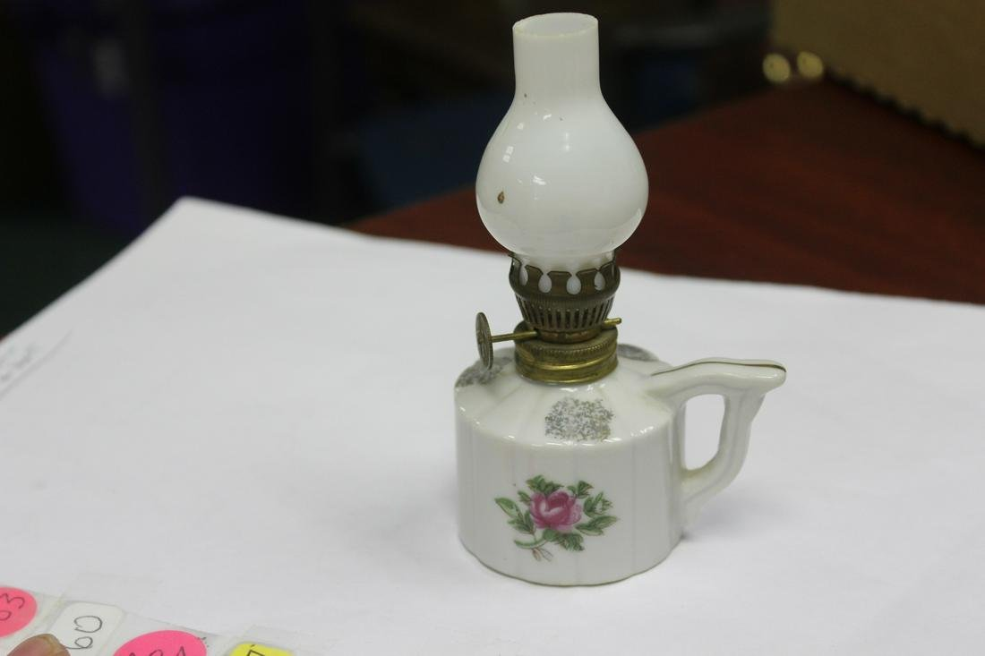 A Porcelain Miniature Oil Lamp