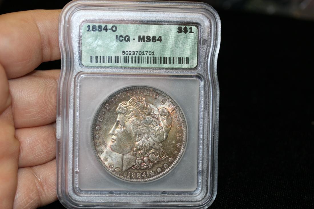 An ICG Graded 1884-O Morgan Silver Dollar