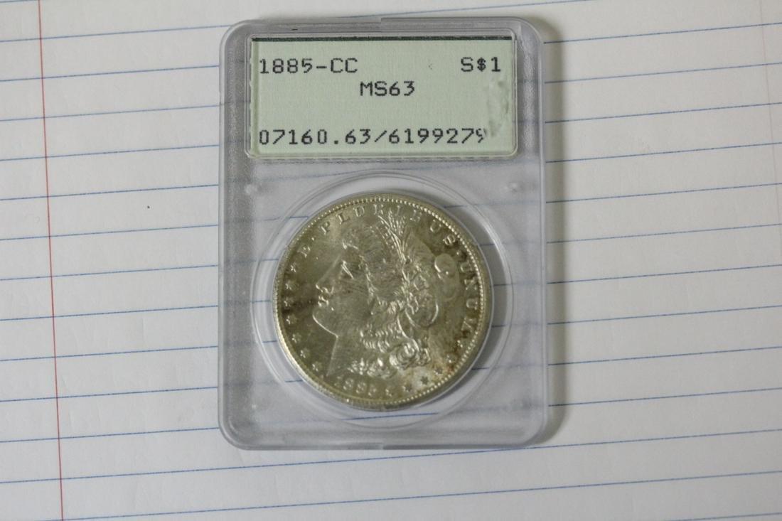 A Very Rare 1885-CC Graded Morgan Silver Dollar