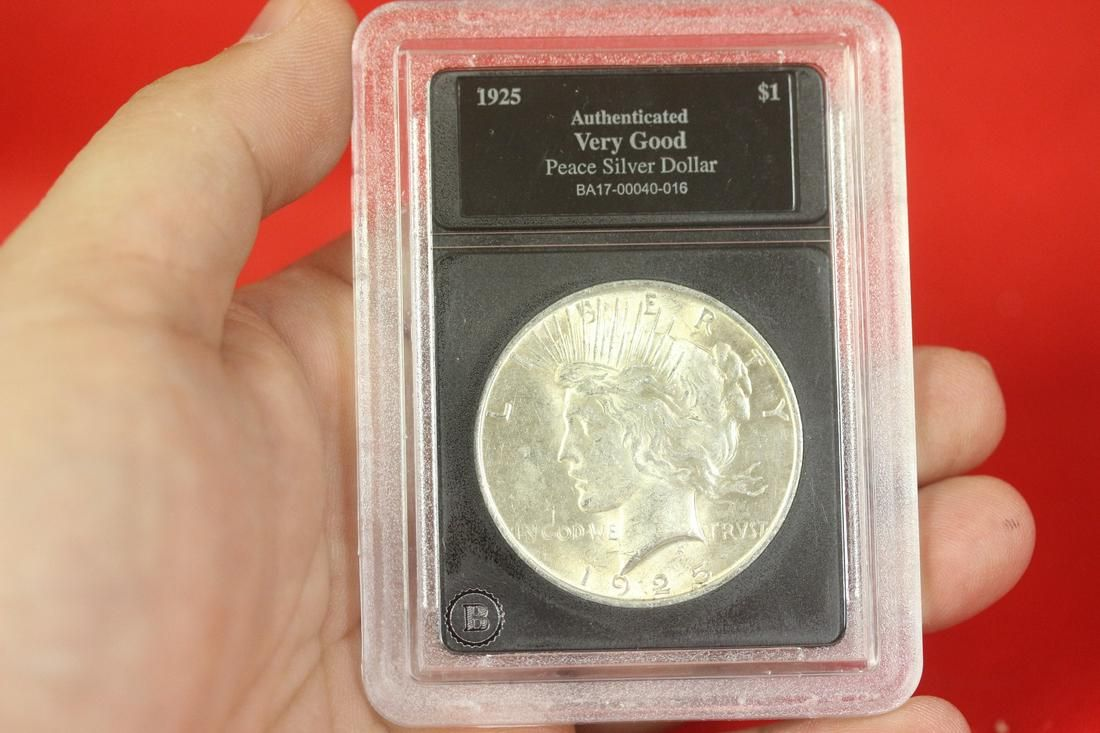 A 1925 Graded Peace Silver Dollar