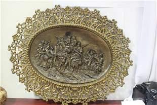 A Framed Bronze Plaque