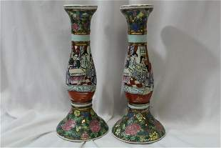 A Pair of Chinese Rose Medallion Candle Sticks