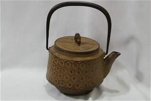 A Japanese Tetsubin or Cast Iron Kettle