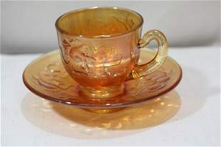 An Iridescent Carnival Glass Cup and Saucer