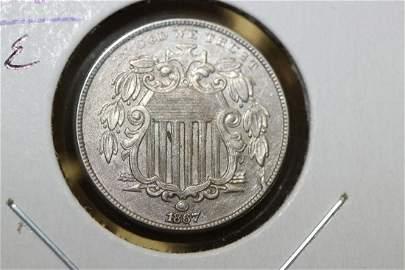 An 1867 Mint Error Double Die Shield Nickel