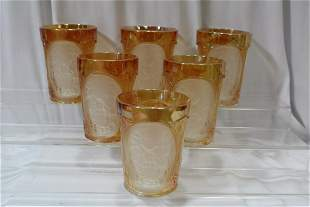 A Carnival Glass Pitcher and Six Cups