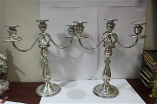 A Pair of Weighte Sterling Candelabra