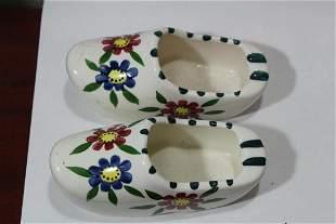A Pair of Ceramic Clog Ashtrays