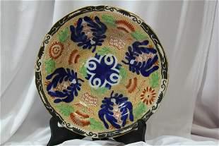 An Antoque Flat Potter Bowl