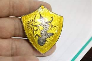 An Amfarco Enamel Pin or Brooch