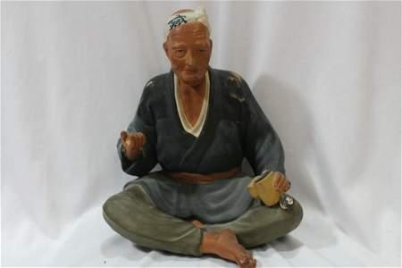Oriental Mud Man