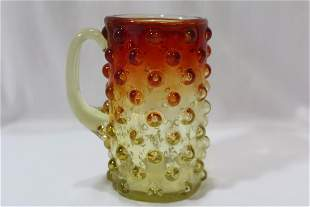 An Amberina Glass Cup