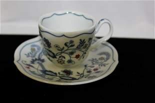 An Avon Cup and Saucer