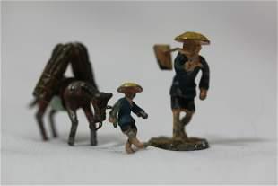 Lot of 2 Miniature Oriental Cast Iron Man