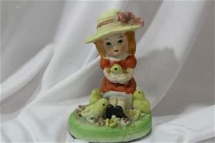 A Ceramic Girl Figurine