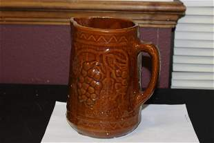 An Antique Most Likely Majolica Brown Pitcher Pitting