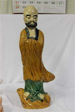 A Large Chinese Pottery Figurine