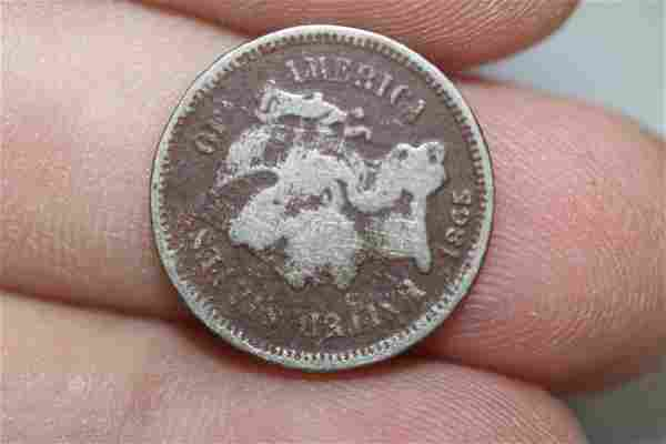 An 1865 Three Cent Piece