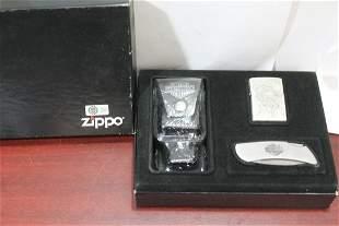 A Harley Davidson Zippo Lighter/Holder/Knife Set