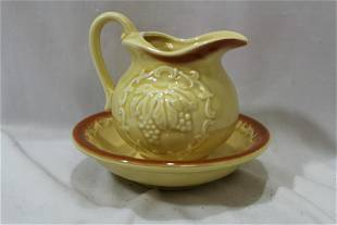 A Ceramic Pitcher and Undertray