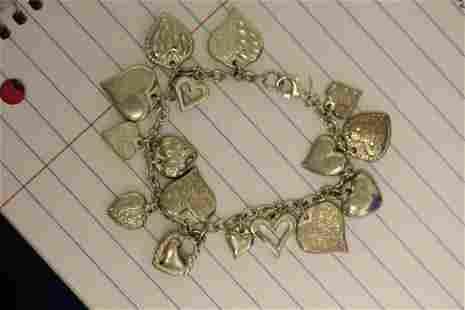 A Sterling Heart Charm Bracelet