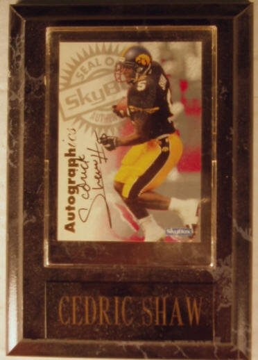 1002: Cedric Shaw: sgnd card plaque - Appraised at $60.