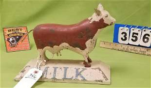 "FOLK ART WOODEN COW FIGURINE, 8.5""H X 11.5""W X 5""D"