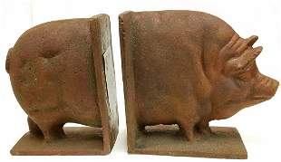 "CAST IRON PIG BOOK ENDS, 6""H X 10""L"