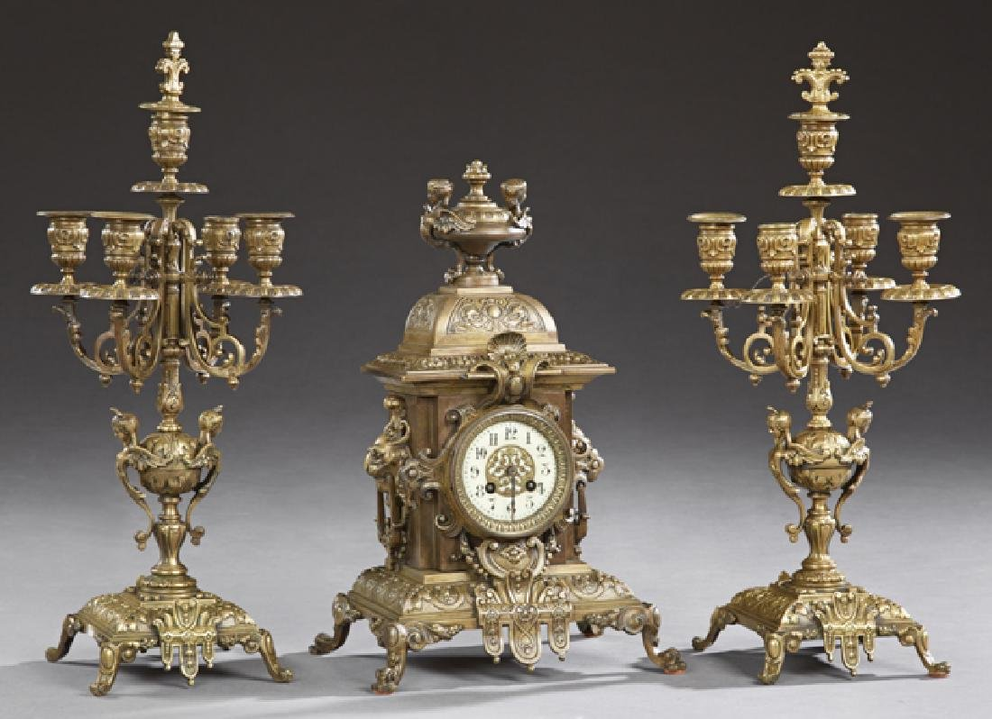 French Three Piece Bronze Clock Set, 19th c., with a
