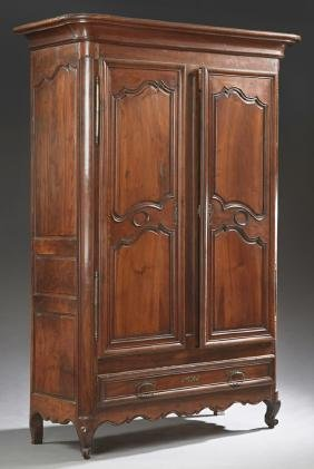 French Carved Walnut Louis XV Style Armoire, early 20th