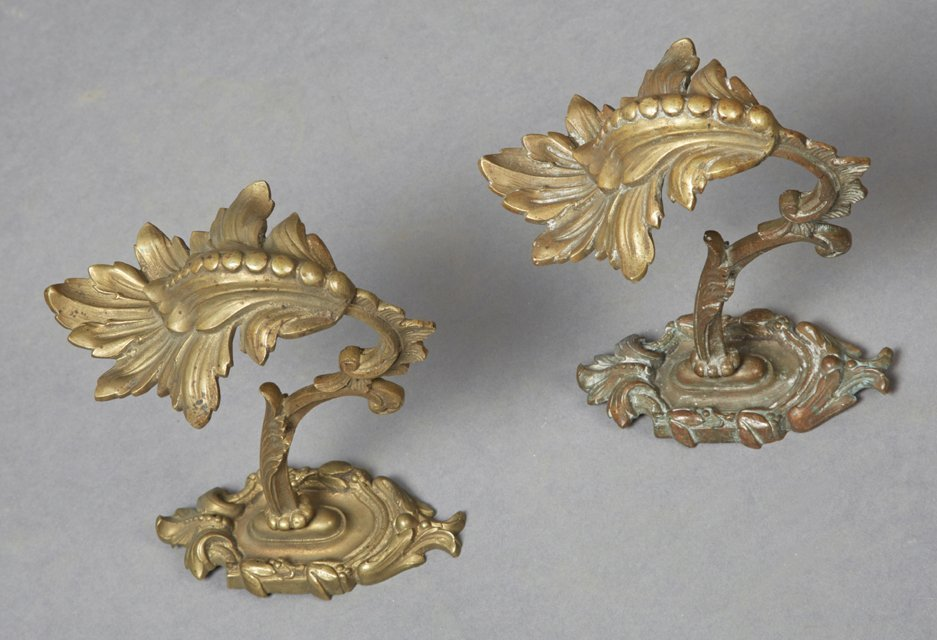 Pair of Bronze Curtain Tiebacks, 19th c., with oval