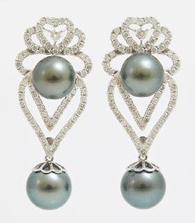 Pair of 14K White Gold Pierced Earrings, each with an