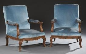 Pair of French Louis XV Style Carved Walnut Fauteuils,