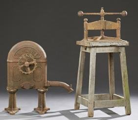 Two Pieces of French Cast Iron, 19th c., consisting of