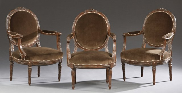 Set of Three Louis XVI Style Carved Walnut Fauteuils,