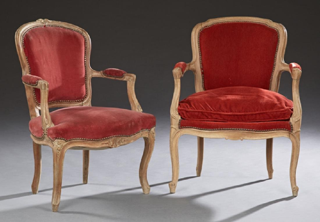 Two French Carved Beech Fauteuils, early 20th c., with